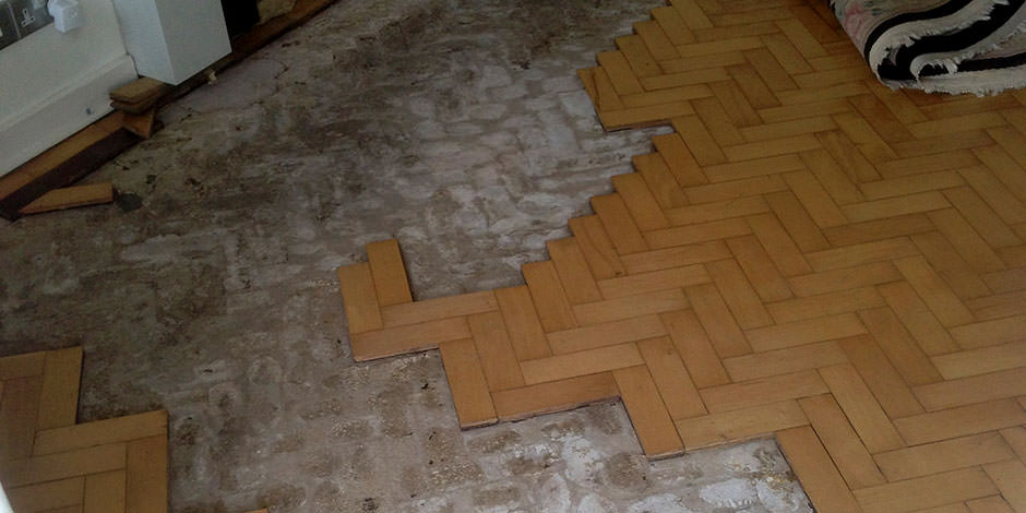 Before-ENTRANCE ARE REPAIRED AND OILED BEECH PARQUET FLOORING IN HENDON
