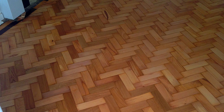 After-ENTRANCE ARE REPAIRED AND OILED BEECH PARQUET FLOORING IN HENDON