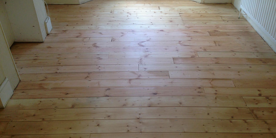 After-LOUNGE REPAIRED PINE BOARDS IN ISLINGTON